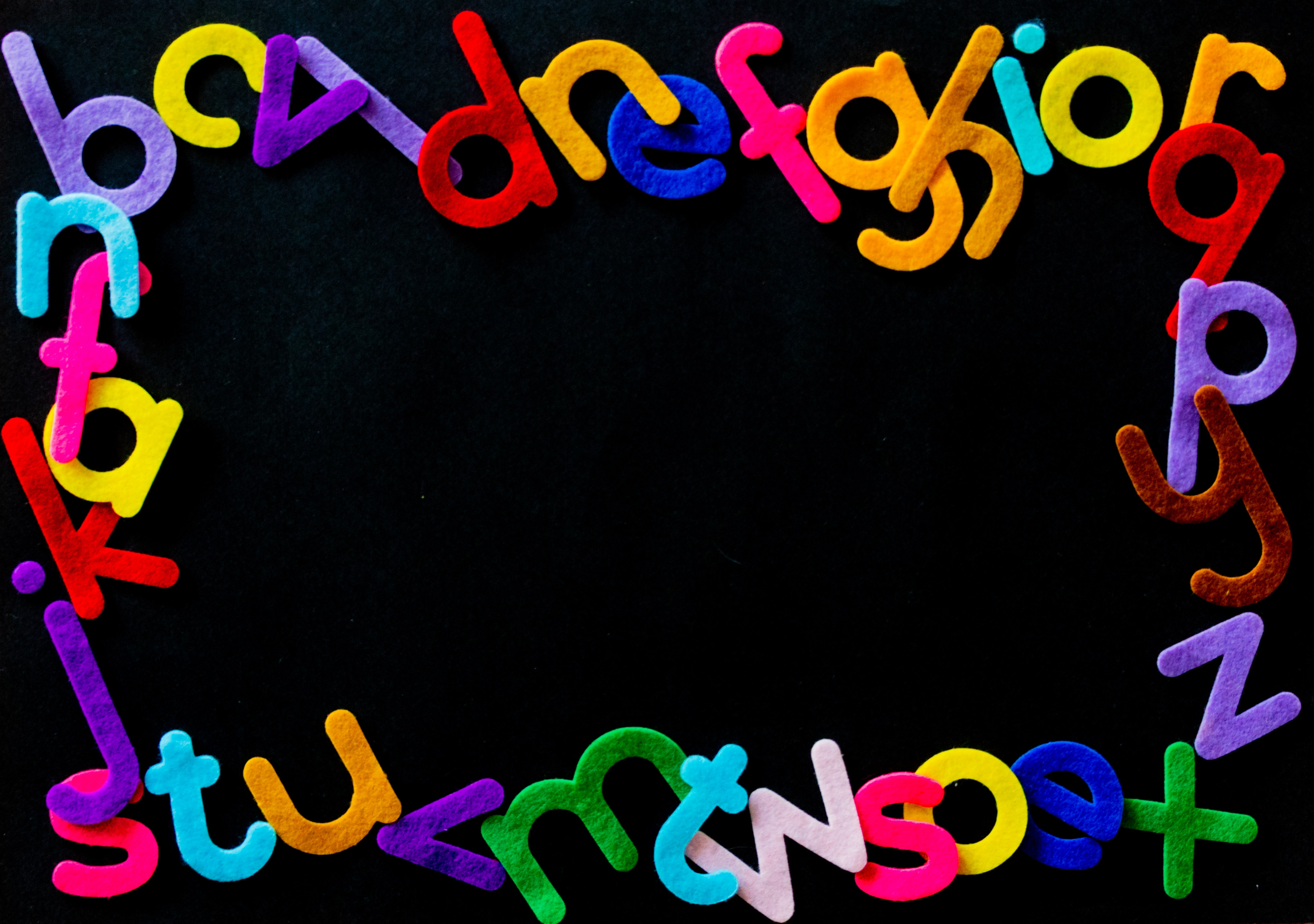 black-background-with-alphabet-letters-text-overlay-1339356